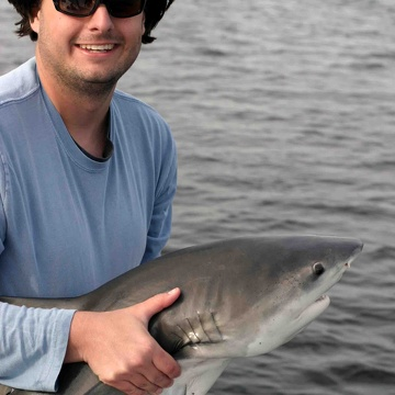 Bryan Delius (M.S. student) with a bull shark in Shark River