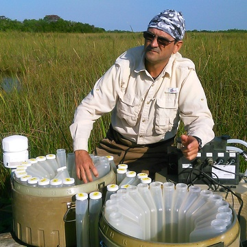 Rafael Traveiso collecting water samples from the autosampler at SRS-3, Shark River Slough