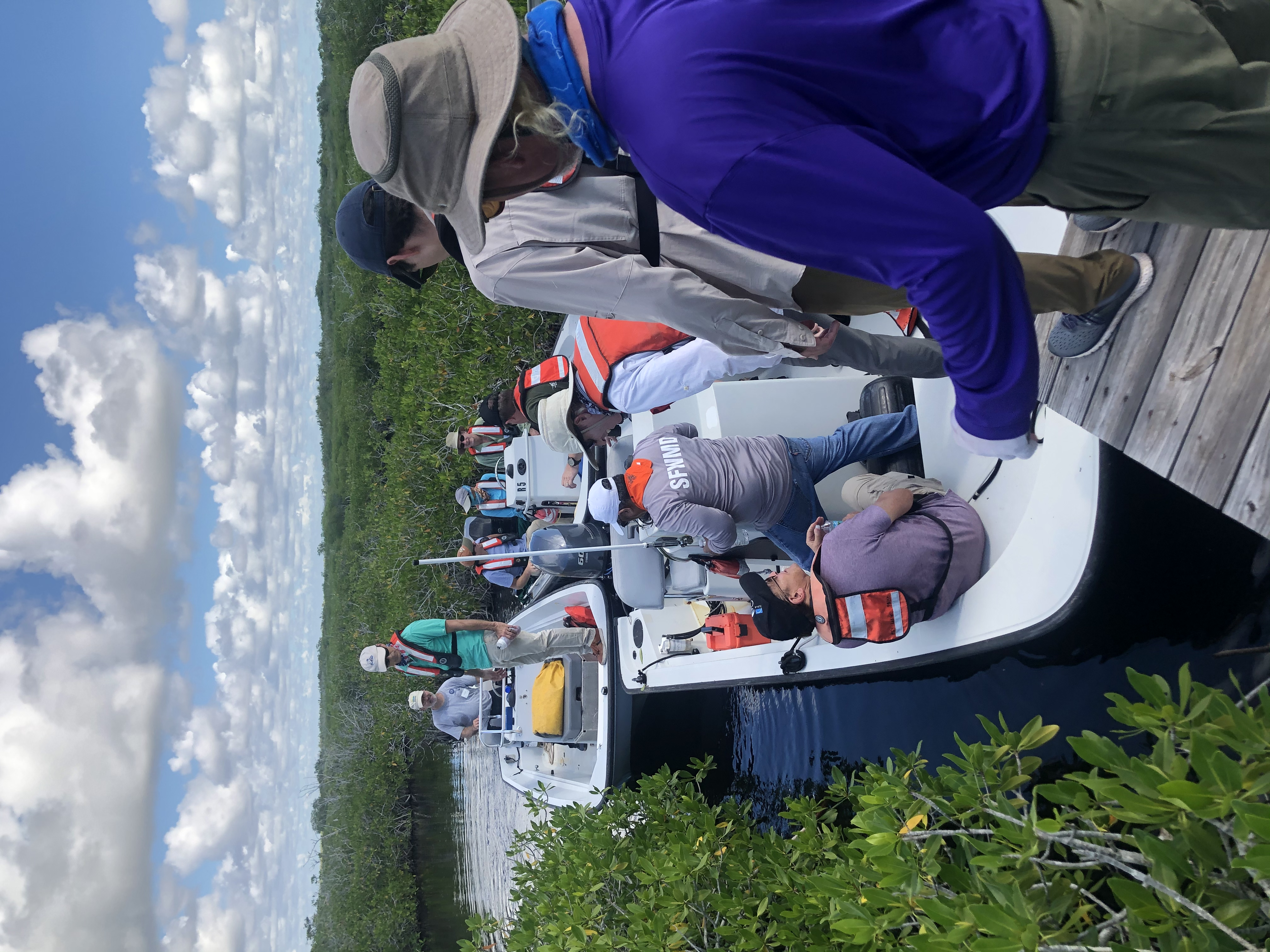 CISRERP committee getting in boats after visiting FCE site TS/Ph-7b
